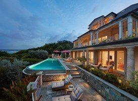 canouan-accommodation-lagoon-villa-exterior-3cz9n9qjwcnr43ndd6p88w.jpg