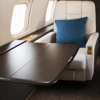 vistajet-challenger-850-table-seating-scaled-3cip83tb1pd51kev94gq2o.jpg